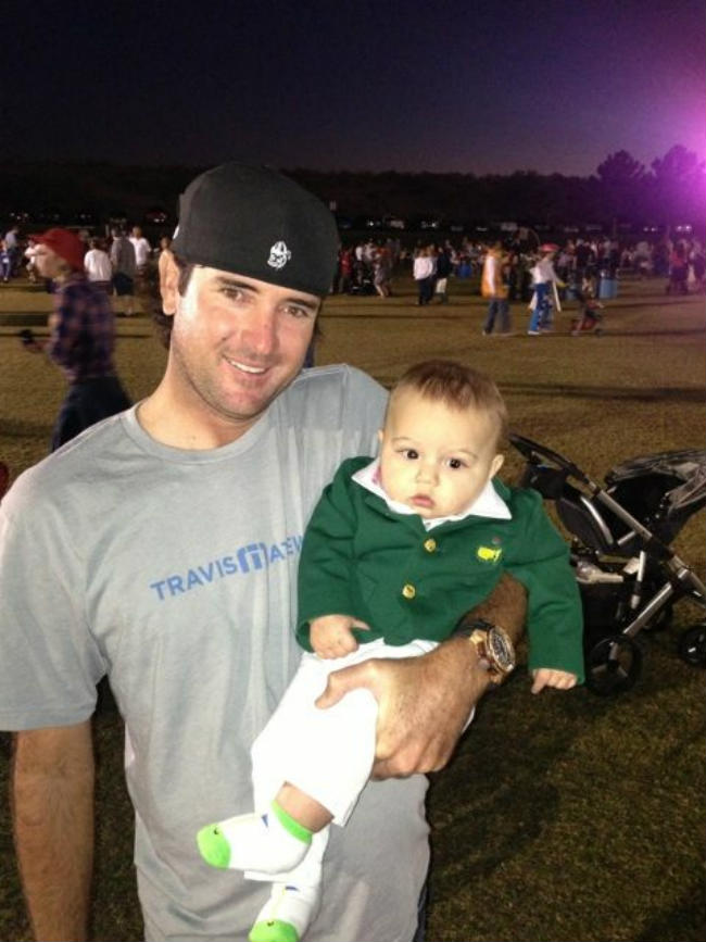 PGA golfer Bubba Watson poses for a photo with his son.