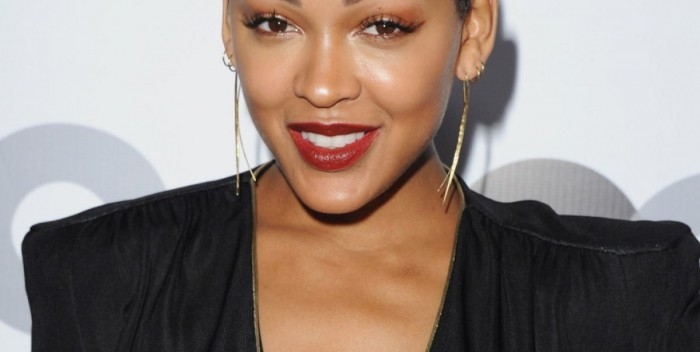 Meagan Good is seen wearing a revealing black sheer dress at the GQ Man of the Year 2013 event.
